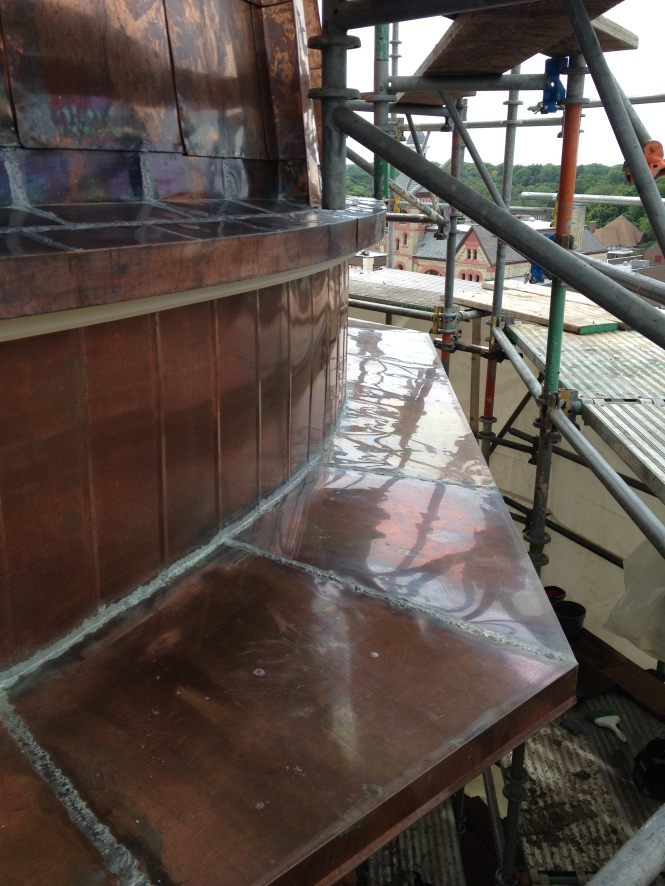 New copper with soldered seams will last a long time compared to the aluminum roof with caulked seams that was part of the bid alternates. The difference between copper and aluminum was just over $50,000. Well worth the increase in price due to longevity and less maintenance.