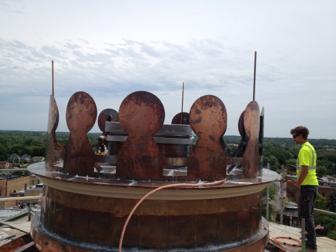 This image shows the lightning protection system being installed. There was no lightning protection on the cupola previously! With a new copper roof it was important to provide this safety feature to protect the City's investment in this historical structure.