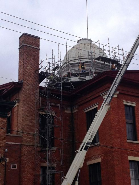 The elaborate scaffolding system being installed