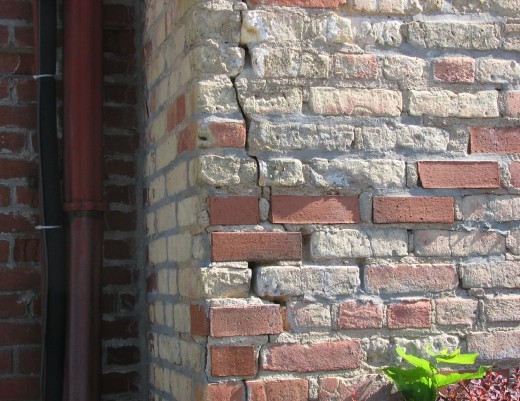 The south side of the Sheriff's House and the Courthouse needed immediate repairs to stop the spalling of brick faces, cracking, and bricks falling off the building.