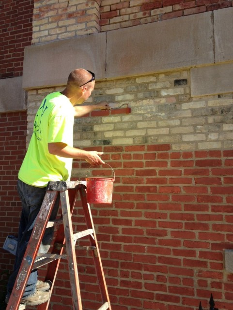 The contractor stained the bricks to match the rest of the building that was stained many years ago.