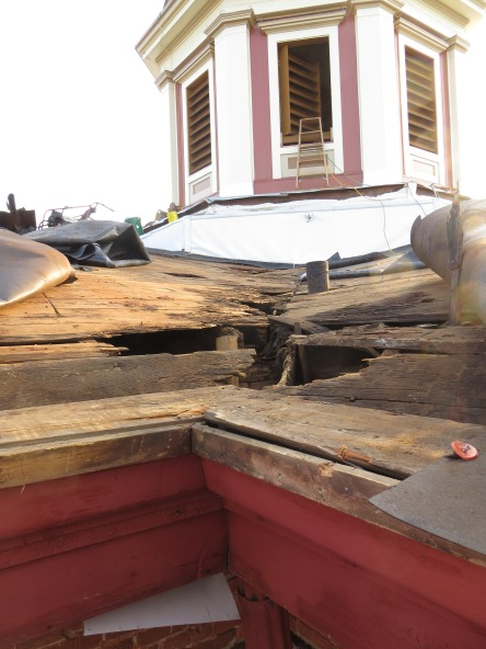 Years of water leaking through the roof at several locations caused the wood framing and roof decking to become severely deteriorated and structurally unsafe. Luckily the City of Woodstock was able to bring the roof and underlying framing members into a safe and sound condition.